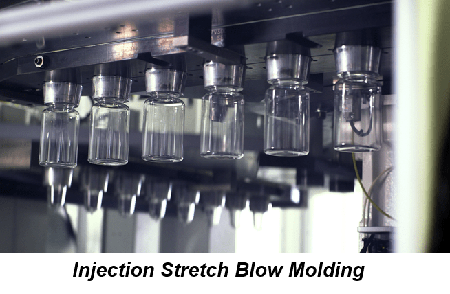 Clear plastic resin bottles are shaped on an assembly line during the injection stretch blow molding process.